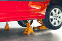 Once you reach a desired height, install a jack stand at the jack pad location to support the vehicle.