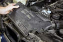 Next, remove the intake air duct from your radiator support by lifting it up and out of the intake air housing duct.