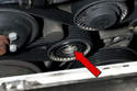 Once your dust cap is removed, youÃÆ'â€Ã...Â¡'ll have access to the 8mm Allen nut (red arrow) used to rotate the tensioner.