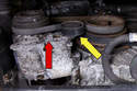 Locate your A/C drive belt tensioner; use a 16 mm hex socket (red arrow) or remove the dust cap (yellow arrow) to access the Allen bolt, if 16mm hex is not present.