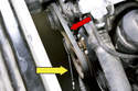 Using a ratchet with a long handle and an 8mm socket or a 16mm open end wrench (yellow arrow, depending on style of tensioner), rotate the A/C belt tensioner clockwise to release tension and slide the belt (red arrow) off the pulleys.