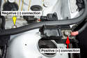 Connect one end of positive jumper cable to positive (+) battery terminal of the vehicle with the good battery.