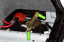Remove the battery fasteners (green arrows) and remove the bracket.