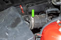 While working at the air filter housing, loosen the air flow meter clamp (green arrow).