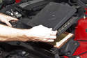 Lift the top of the air filter housing up and remove from the vehicle.