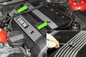To remove the E46 intake manifold side engine cover: use a small flathead screwdriver, pry out the trim covers and remove the 10mm fasteners (green arrows), then remove trim cover from your engine.