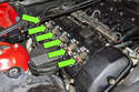 BMW E46 models utilize an individual ignition coil for each spark plug, referred to as coil over plug (green arrows).