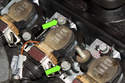 Next, remove two 10mm ignition coil fasteners (green arrows).