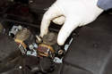 Remove the ignition coil from the cylinder head by it pulling straight up.
