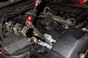 """Using a 5/8 spark plug socket on a 12"""" extension, remove the spark plug from the cylinder head."""