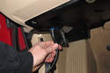 Plug scan tool into OBD II connector.