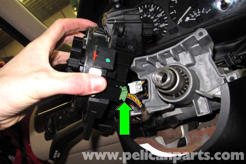 bmw e46 steering column switch replacement bmw 325i (2001 2005working at bottom of switch assembly, disconnect electrical connector by releasing retaining tab and pulling