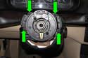 Then, remove four T25 Torx head screws (green arrows).