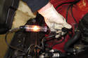 Connect a test light or DVOM across washer pump electrical connector terminals.