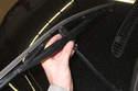 Slide wiper blade off wiper arm.