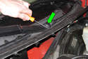 Open hood, then gently pry wiper arm nut trim cap using a small flat-head screwdriver.