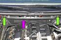 Remove two T30 Torx fasteners (green arrows) from blower motor bulkhead (purple arrow).