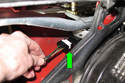 Then disconnect wiper motor electrical connector by release tabs and sliding off (green arrow).