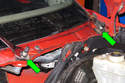 Remove two 24mm nuts from wiper pivots (green arrows).