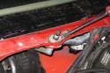 Using a flat-head screwdriver, lever off rubber insulators from wiper pivots.