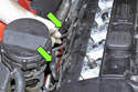 Next, pull oxygen sensor electrical connectors out of holder and lay aside (green arrows).