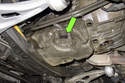 Working at oil pan, squeeze oil level sensor electrical connector and pull off to remove from sensor (green arrow).