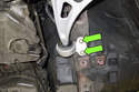 Remove front control arm bushing fasteners (green arrows).