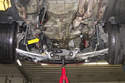 With all the subframe components and subframe fasteners removed, you can lower the subframe.