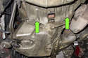 Then remove two E10 fasteners from the transmission bell housing (green arrows).