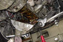 With all 25 fasteners removed, lower and remove the oil pan from the engine.