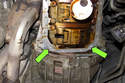 Before installing new gasket, apply a small amount of RTV sealant to the engine crankcase halves (green arrows).