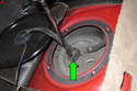 Disconnect fuel pump electrical connector by sliding locking tab using a flat-head screwdriver, then pulling connector off fuel pump module.