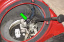 Connect fuel line with new hose clamp (green arrow).