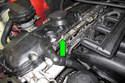 Remove fuel test port cap (green arrow).