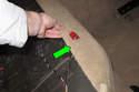 Next, peel carpet away from seat cushion area of body (green arrow).