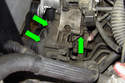 Remove the three 13mm power steering pump fasteners (green arrows).