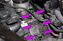 Remove the six 13mm oil filter housing fasteners (purple arrows).