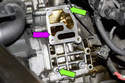 Clean the engine sealing surface (purple arrow), inspect the alignment dowels (green arrows), they help you align housing when reinstalling.