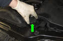 When pressure testing a cooling system, be sure the vehicle is cool and lacks pressure before removing the coolant expansion tank cap (green arrow).
