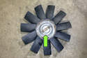 This photo shows the fan clutch, installed on the cooling fan (green arrow).