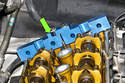 Install camshaft locking jig (11 3 240) at rear of camshafts.