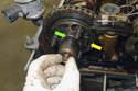 Slide exhaust camshaft splined shaft into camshaft sprocket.