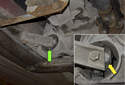 The problematic rubber mount (green arrow) is located in the transfer case.