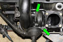 Remove the crankcase breather valve fasteners (green arrows) and remove crankcase breather valve from the engine.