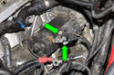 Then remove 8mm and 10mm nuts for starter electrical connection (green arrows).