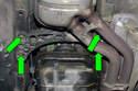 Next, place a jack under the transmission mount.