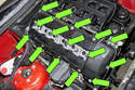 Remove the fifteen 10mm valve cover fasteners (green arrows).