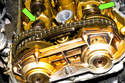 Rotate the engine clockwise until the first camshaft lobes point toward each other (green arrow).