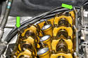 Remove the studs at rear of the cylinder head using a 10mm deep socket (green arrow).