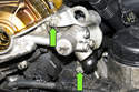 Remove the engine hoisting hook fasteners and remove the hook from engine (green arrow).